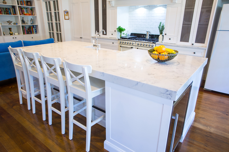 Featuring large wide island bench with Smart Stone Athena and Hampton style cabinetry