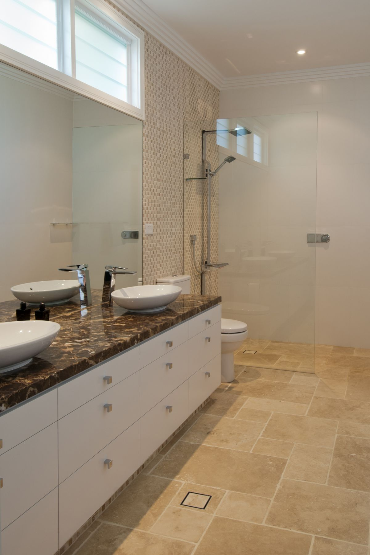 Stunning ensuite with caesar stone benchtop and 2pac cabinetry with drawers for ample storage
