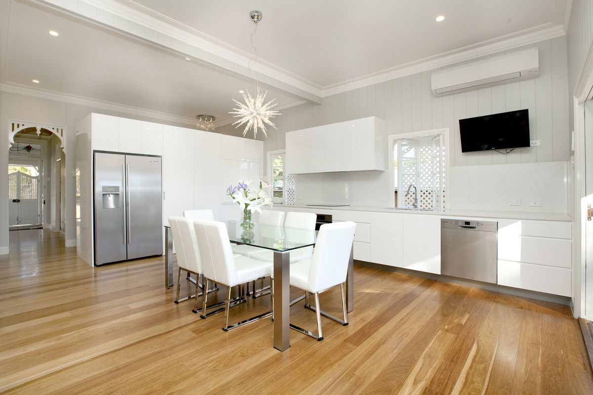This stunning timeless white kitchen with Smart Stone Carrara provides the central hub to the home in Graceville